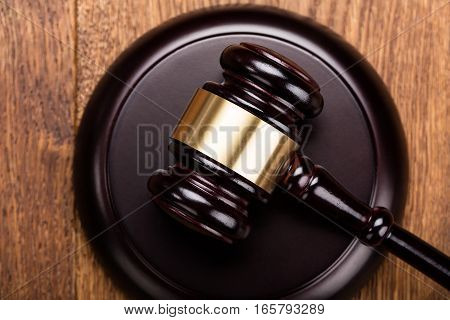 Close-up Of Wooden Gavel At Wooden Table