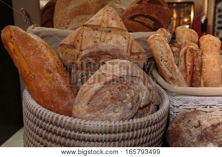Heap Of Bread Rolls Assortment And French Loaf Inside Wicker Basket