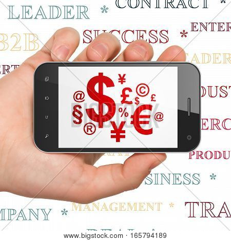 Business concept: Hand Holding Smartphone with  red Finance Symbol icon on display,  Tag Cloud background, 3D rendering