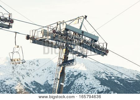 Empty Ski Lift Chair Going Down From The Very Top Of A Mountain