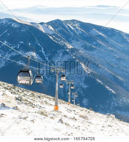 CHOPOK SLOVAKIA - JANUARY 12 2017: Cable cars going up and down Chopok mountain at the Jasna ski resort area on January 12 2016 - Slovakia