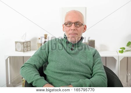 portrait of senior man with glasses looking at camera