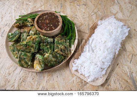 Cha om egg and rice on wood tray ready to eat