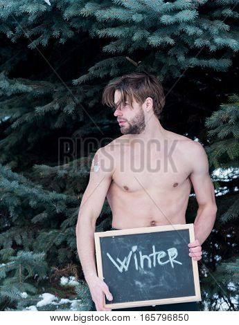Handsome Muscular Man With Winter Blackboard Outdoor
