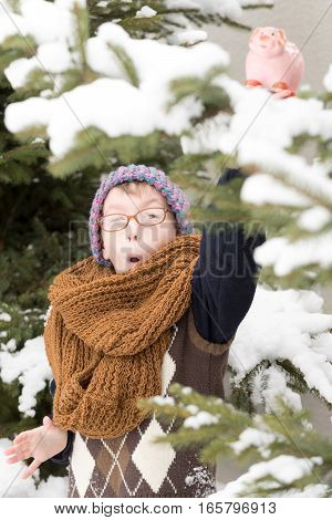 Small Boy With Moneybox In Winter Outdoor