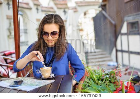 Woman At The Cafe With A Cup Of Coffee