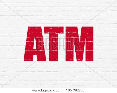 Money concept: Painted red text ATM on White Brick wall background