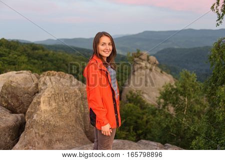 Woman Hiker On Big Rock On Top Of The Mountain