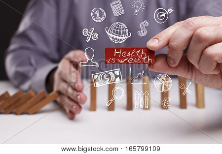 Business, Technology, Internet And Network Concept. Young Businessman Shows The Word: Health Is Weal