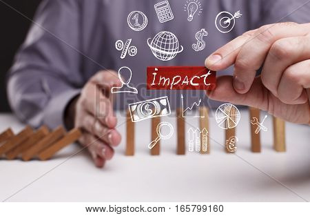 Business, Technology, Internet And Network Concept. Young Businessman Shows The Word: Impact