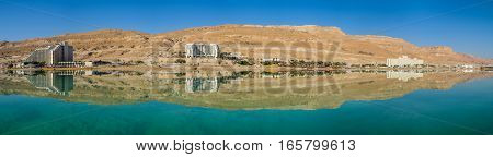 Large Panoramic View Of Hotels Line At Dead Sea Beach. Israel