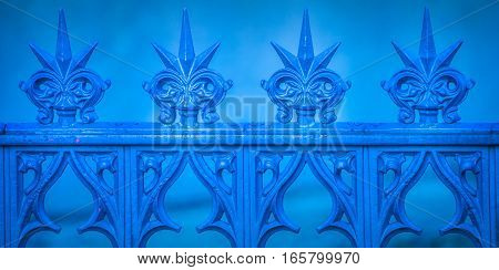 Spiky blue and abstract fence with ornaments