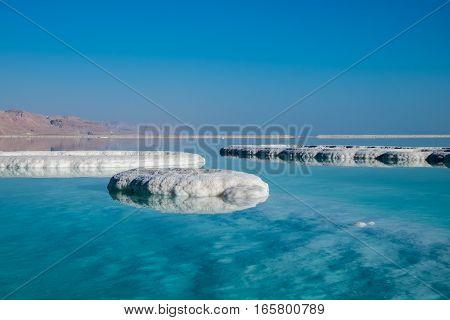 Dead Sea Salt On Beach At Sunrise. Israel