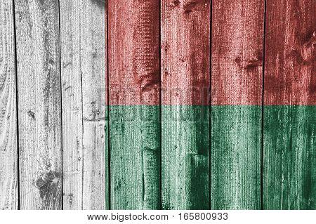 Flag Of Madagascar On Weathered Wood