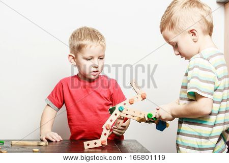 Children Play With Toy On Table.