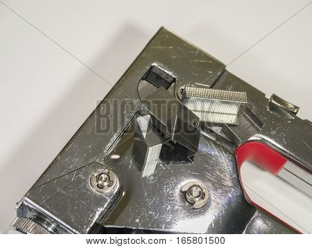 Staple gun and staples on white background closeup. Isolated.