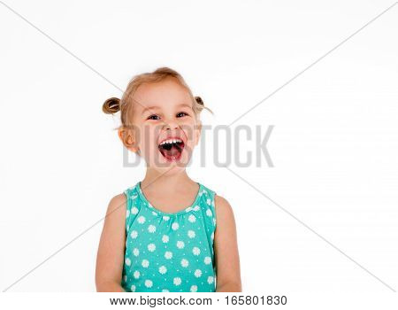 cute little girl 4 years defiantly shouts. rejoices. isolated on white background