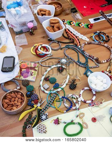 The process of creating jewelry with wire, beads and crystals. Working tools on the table. Handmade jewelry