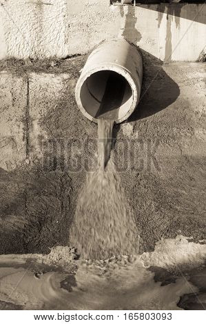 Concrete Circular Pipe Discharging Water To A Canal