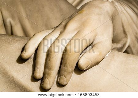 A carved marble hand from a sculpture