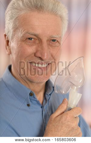 mature man with oxygen mask, close up