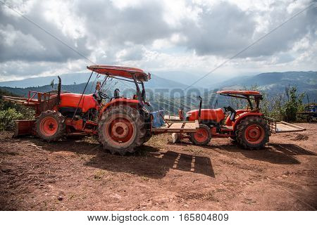 image of Farmer with tractor seeding crops