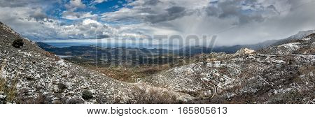 Panoramic View Of Snow On Mountain Village Of Speloncato In Corsica