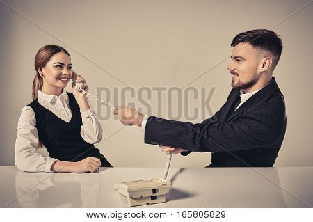 picture of man and woman with telephone at the table. Emotions