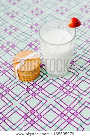 Transparent glass with milk and cookies. Health