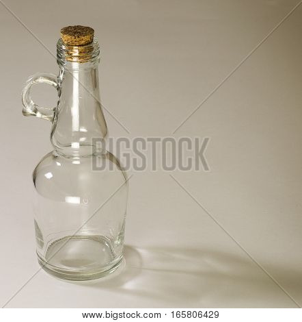 one empty glass bottle on white background
