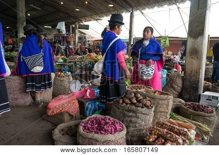 September 6, 2016 Silvia Colombia: Guambiano women selling produce in the local market dressed in traditional clothing