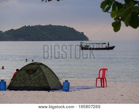 Tent chair on the beach boat sea ocean island