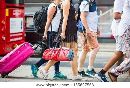 London, UK - August 24, 2016: People walking in Oxford street, the main destination of Londoners for shopping. Modern life concept