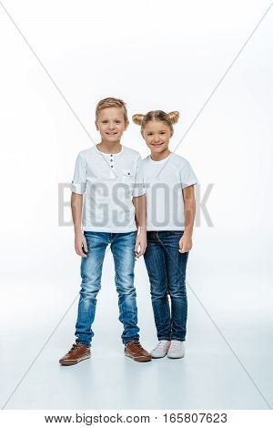 Smiling brother and sister in white background