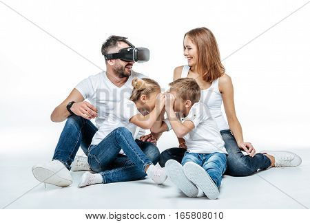 Man in virtual reality headset with family
