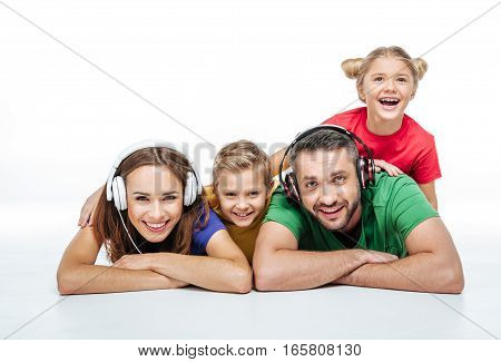Parents in headphones with kids isolated on white