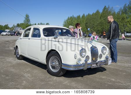 KERIMAKI, FINLAND - JUNE 06, 2015: Jaguar Mk. I (1956), the parade of vintage cars in the area of South Savo. Finland