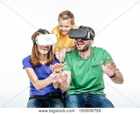 Portrait of family using virtual reality headsets isolated on white