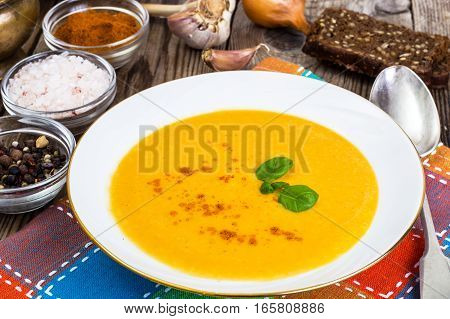 Vegetable cream soup with celery, pumpkin, basil. Studio Photo