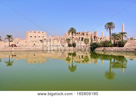 LUXOR, EGYPT: Reflections on the Sacred Lake at Karnak temple