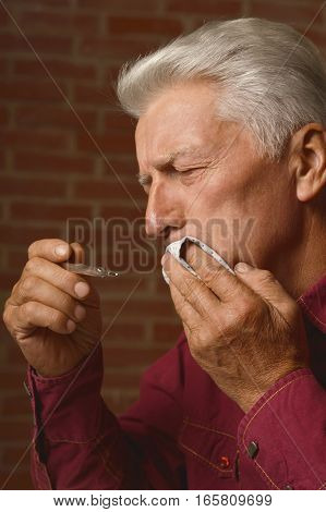 mature man had s toothache, close up