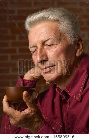 Portrait of a man drinking tea, close up
