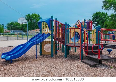 Happy Childhood kid playground fun for leisure and recreation activity with toy,stairs slides equipment leftover and climb.Nobody season ladder nature ground outdoor on yard in the park in color style