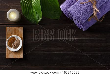 Spa treatment and aromatherapy concept background. Zen stones, aroma salt, oil, soap, details and accessories for wellness body care and alternative medicine. Flat lay, top view with copy space