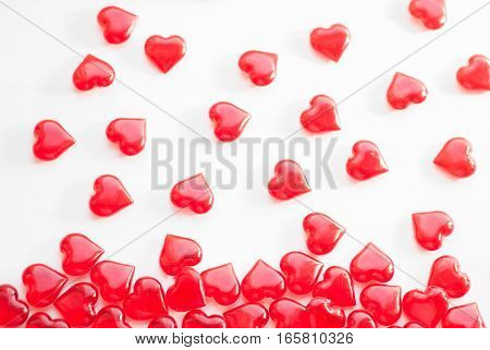 Hearts are falling down, Red lollipops on a white background. The concept of love. Valentine's Day.