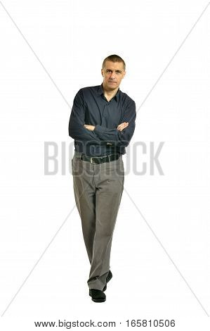 Confident smiling man in full length on a white background