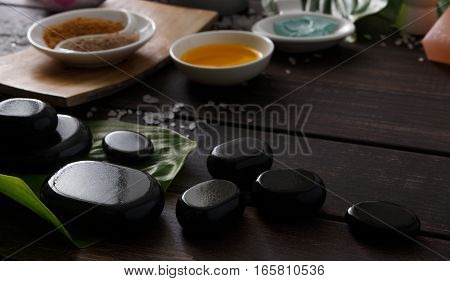 Spa treatment and aromatherapy concept background. Zen stones, aroma salt, spices, herbal balls, oil and soap, candle and other details of wellness body care and alternative indian medicine.