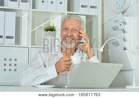 Portrait of a handsome mature businessman working at office