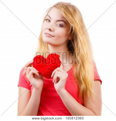 Woman blonde long hair girl holding red heart love symbol studio shot isolated on white. Valentines day happiness concept