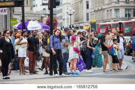 London, UK - August 24, 2016:  Lots of people crossing the Regent street at the traffic lights. Populated city concept